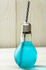 glass of blue energy water on the table, lamp concept idea