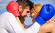 Leinwanddruck Bild - Family life happiness and relation problems. Reconciliation and compromise. Fight for your happiness. Man beard and girl cuddle happy after fight. Couple in love boxing gloves hug blue sky background