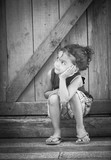 young child looking to side thinking