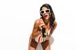 Leinwanddruck Bild - Woman in swimwear drinking soda.
