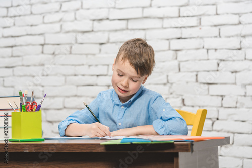 Foto Murales Young boy learning for school with his books