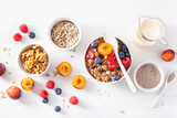 healthy granola for breakfast with berry fruit nut, vegan milk - 217882049