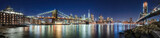 The skyscrapers of Lower Manhattan, the Brooklyn Bridge and the Manhattan Bridge in evening with the East River (panoramic). New York City - 217886819