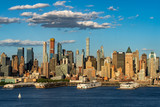 The skyscrapers of Manhattan Midtown West with the Hudson River in afternoon light. New York City - 217886865