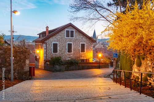 Foto Murales Typical French houses in Old Town of Annecy during morning blue hour, France