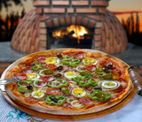 Portuguese Pizza, onion, peppers, pepperoni, egg, olive
