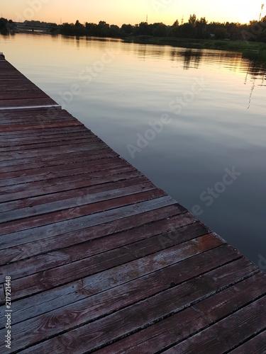 Aluminium Pier the river at sunset