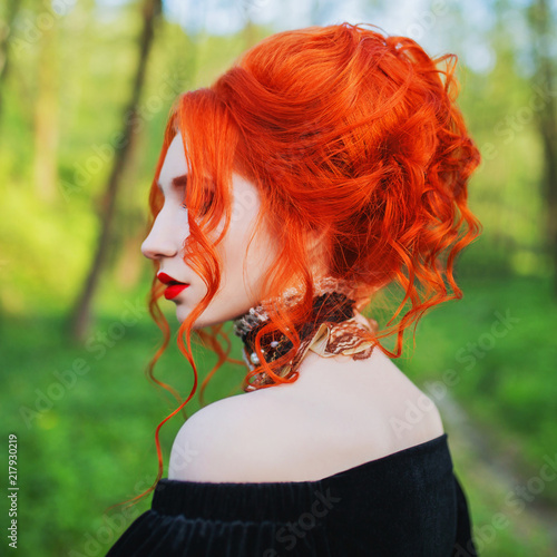Foto Spatwand Kapsalon Wave hairdo in salon. Stylish halloween hairstyle. Gothic redhead woman is vampire with pale skin and red hair in dress and necklace on neck. Gothic hairstyle. Long wave hair. Renaissance hairdo