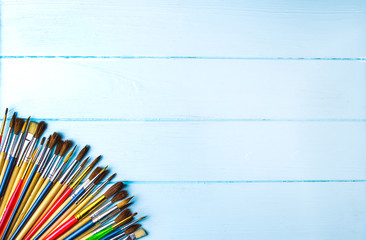 Paint brushes and paint on an background. © bukhta79