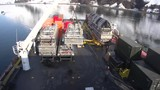 Off shore barge. Heavy machinery. Workers in hard hats. - 217944051