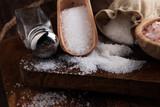 Salt Shaker and salt on wooden table. - 217948859