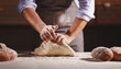 Leinwanddruck Bild - hands of baker's male knead dough