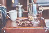 Hot coffee and coffee beans on the background of coffee grinders. - 218005467