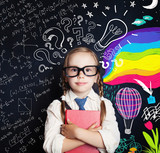 Creativity education, new ideas and right and left hemispheres of the brain concept. Smiling little girl on blackboard background with math and art pattern - 218009697