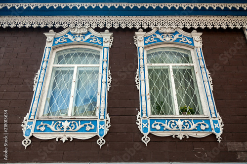 Close-up of a two old windows in old house a mansion made of stone brick