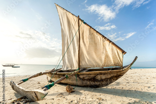 Canvas Zanzibar A Dhow boat on the beach. Sailing boat on the shore.