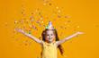 Leinwanddruck Bild - happy birthday child girl with confetti on yellow background