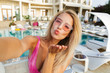 Leinwanddruck Bild - Happy young woman in swimsuit, sunglasses