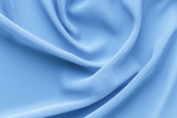 light blue fabric with large folds, delicate background