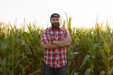 American farmer in cornfield. Farmer, close up of face in corn field. Farmer having fun and dancing, looking at camera. farming concept advanced technology in agriculture - 218036229