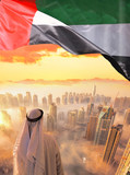 Arabian man watching cityscape of Dubai with modern futuristic architecture in United Arab Emirates. - 218043442