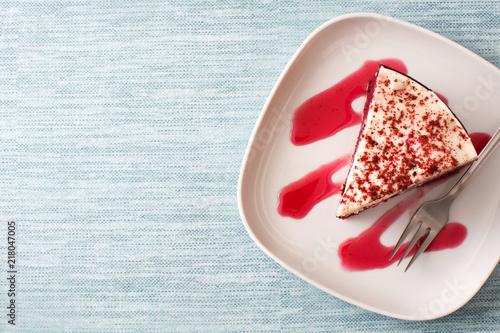 Foto Murales Red Velvet cake slice on blue background. Top view. Copyspace