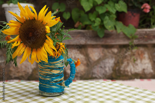 Foto Murales Sunflower in Vase on Table