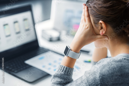 Leinwanddruck Bild app design, technology and failure concept - stressed web designer with smart watch working on user interface