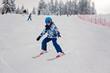 Leinwanddruck Bild - Cute preschool child, skiing in Austrian winter resort on a clear day