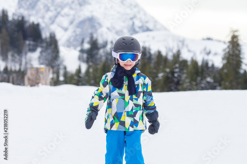 fototapeta na ścianę Young child, skiing on snow slope in ski resort in Austria