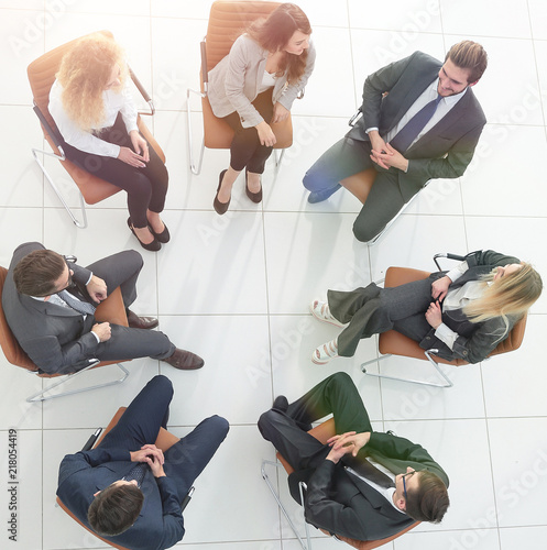 Poster top view of business team discussing new ideas.