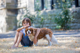 Beaugtiful preschool children, playing with sweet dog in the park