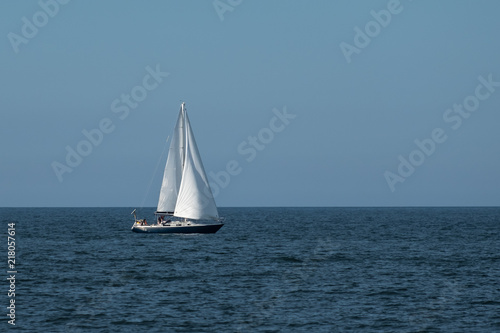 Canvas Zeilen Blue Sailboat at Sea