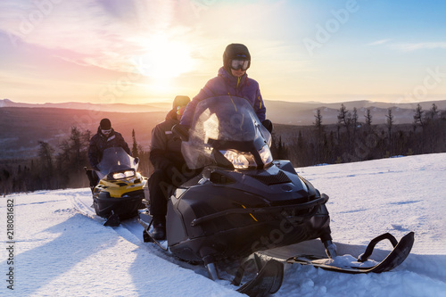Leinwanddruck Bild Athletes on a snowmobile.