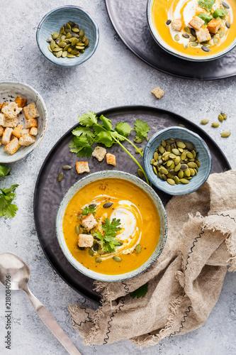 Leinwanddruck Bild Pumpkin soup with cream.
