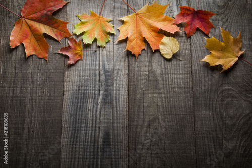 autumn leaf on wood background (top view) orange leaf on old grunge wood deck, copy place for inscription, tablet for text