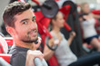 joyful positive man working out in a gym