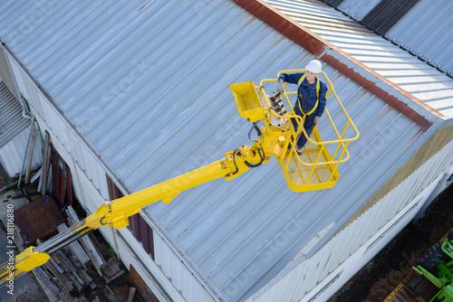 Foto Murales top view of a crane operator working