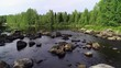 Flying over rocky rapids, Finland