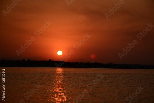 Fotobehang Bruin Beautiful sunset at the beach