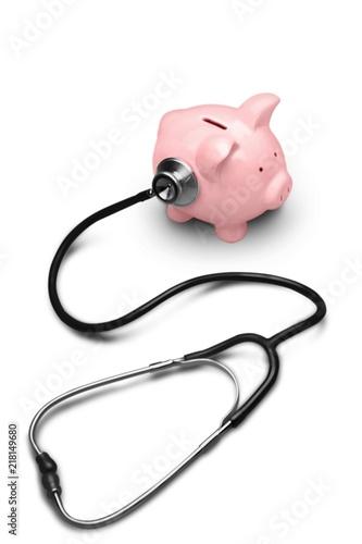 Leinwanddruck Bild Piggy Bank with Stethoscope