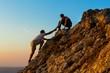 Leinwanddruck Bild - Man Rock Climbing with another Man Helping