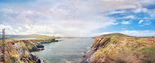 Panoramic landscape with a rocky ocean shore in southwest Ireland. Bray Head Car Park.