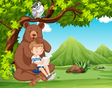 A boy with animals in nature - 218156251