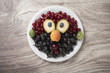 Creative idea of making a face from various berries