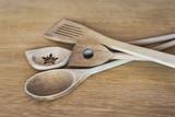 Wooden kitchen stirrers on wooden surface