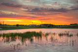 Amazing sunset over the pond in Poland - 218173078