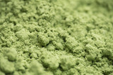 Organic wheatgrass powder background with selective focus - 218176431