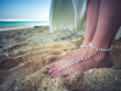 Closeup Decorated Bridal Foots of Beautiful bride at beach, Bali.