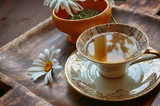 herbal tea with mint, lemon grass and chamomile in the porcelain cup  - 218183821